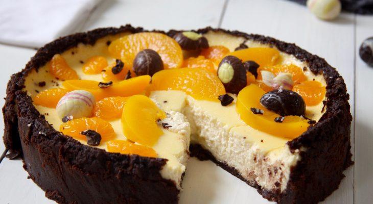 Cheesecake met paaseitjes, perzik en mandarijn